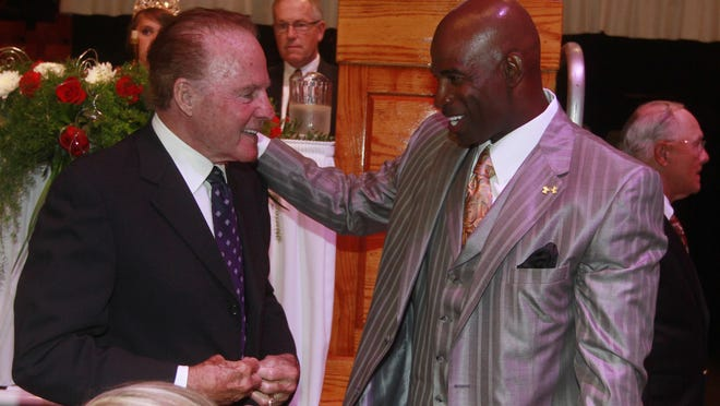 Fort Myers native Deion Sanders greets Frank Gifford at the Pro Football Hall of Fame induction dinner in Canton, Ohio on Friday August 5, 2011.