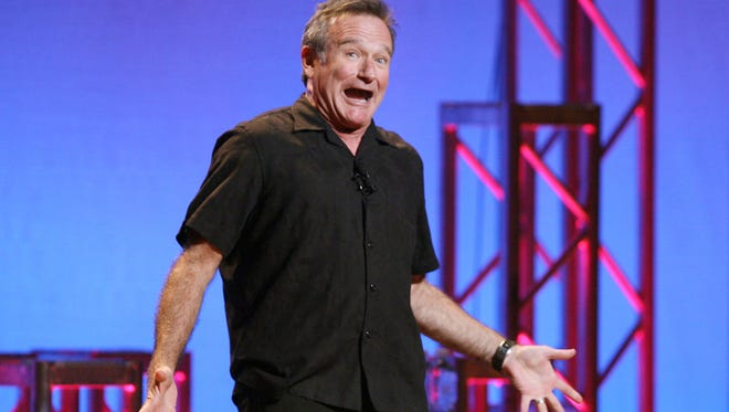 """This Nov. 23, 2009 photo released by Starpix shows actor-comedian Robin Williams performing his stand-up show, """"Weapons of Self Destruction,"""" in New York."""