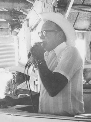 Auctioneer Lem Jones sells Angora goats in Junction about 1975.