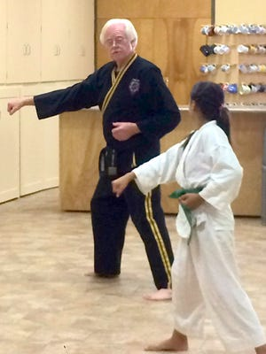 Taekwondo Master Brent Nason instructs one of his students in the martial arts at the Christ First School of Martial Arts at First United Methodist Church. Classes are free and held from 5-7:30 p.m. on Fridays at the church, 1020 S. Granite St.