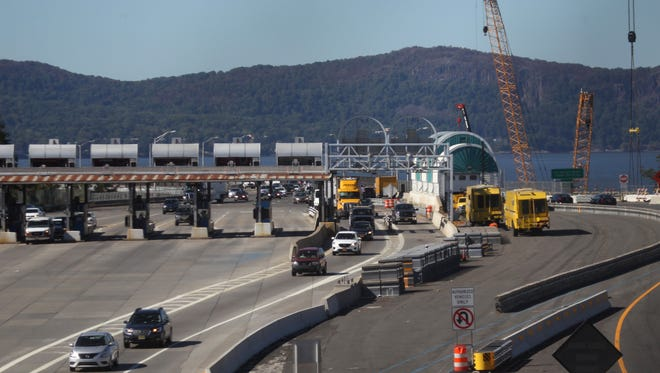 Cars go through the toll booths in Tarrytown after crossing the Tappan Zee Bridge.
