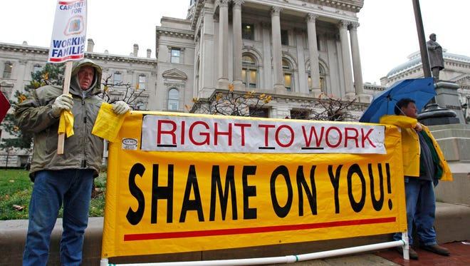 """Union members rallied at the Michigan Statehouse ahead of a 2012 session that would pass a """"right to work"""" law."""