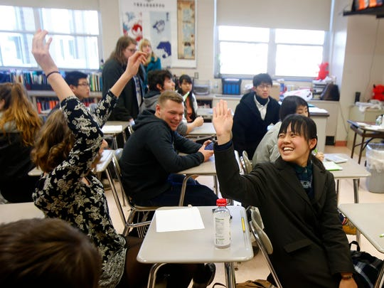 Southern Regional High School junior Delaney Rechenberg, 17, celebrates with Sosa Senior High School student Honami Kita, 15, during a game in Andrea Steinmacher's world language class Monday, March 20, 2017.    Japanese exchange students from the Chiba prefecture have been joining the class.