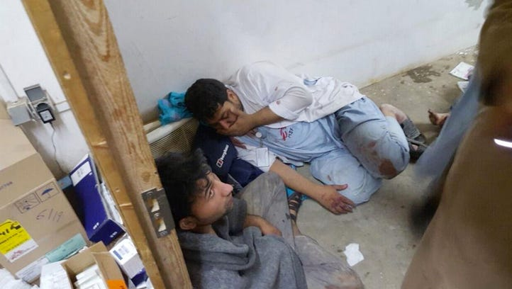 Doctors Without Borders staff are seen after an explosion