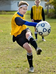 Alex Meiniche, an exchange student from Denmark, takes a shot-on-goal during soccer practice Friday, October 9, 2015 at Richmond High School.
