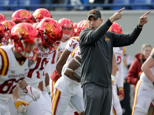 Iowa State head coach Matt Campbell directs his players as they warm up before the Liberty Bowl NCAA college football game between Iowa State and Memphis, Saturday, Dec. 30, 2017, in Memphis, Tenn. (AP Photo/Mark Humphrey)