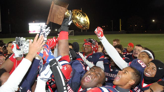 Frank Becerra Jr./The Journal News Stepinac players celebrate their 16-14 victory over Iona to win the CHSFL championship game at Fordham Universityon Nov. 22, 2014. Stepinac players celebrate their 16-14 victory over Iona to win the CHSFL championship game at Fordham University in the Bronx Nov. 22, 2014.