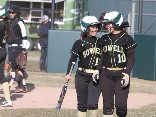 Howell's Sydney Pezzoni (left) and Taylor Frank share a laugh after both scored against Brighton on Wednesday, April 11, 2018.