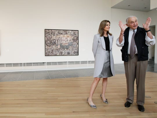 "A 2014 photo of Leslie Wexner (right) and his wife Abigail touring the ""Transfigurations"" exhibit at the Wexner Center for the Arts."