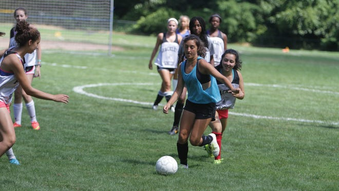 Hackley's Kat Cucullo dribbles the ball while Delia Tager, behind, looks on, during a pre-season practice session at the Hackley School in Tarrytown on August 28, 2015.