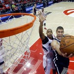 Brooklyn Nets center Brook Lopez goes up for a basket as Atlanta Hawks center Al Horford defends in the first half of Game 5 of a first-round NBA playoff game Wednesday.