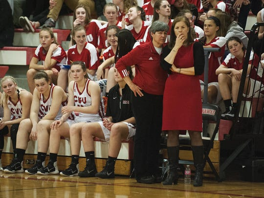 CVU head coach Ute Otley and assistant coach Cathy Kohlasch watch the action on the court during the girls basketball game between the Brattleboro Colonels and Champlain Valley Union Redhawks at CVU high school on Thursday night December 22, 2016 in Hinesburg.