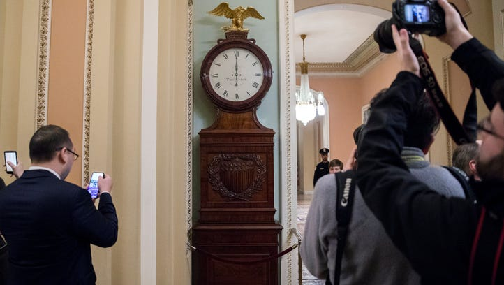 The Ohio Clock is pictured striking midnight as Senate