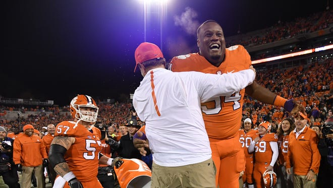 Clemson head coach Dabo Swinney celebrates with defensive tackle Carlos Watkins (94) after Swinney was doused with Gator Ade during the closing seconds of the Tigers 55-7 win over South Carolina on Saturday, November 26, 2016 at Clemson's Memorial Stadium.