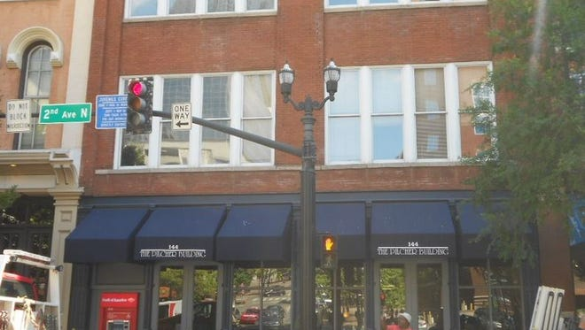 The Pilcher Building is listed as contributing to the Second Avenue National Register Commercial District.