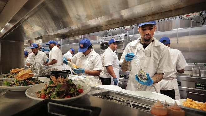 Kitchen staff at Memphis' first Dave & Buster's on Wolf Creek Parkway work on learning their stations during a day of training for employees at the new arcade and sports bar. Managers at Dave & Buster's were finishing up two weeks of training for their 230 new employees in preparation for the entertainment center's grand opening on Monday, Feb. 12, 2018.