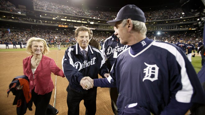 Tigers manager Jim Leyland, right, with Marian and Mike Ilitch after the Tigers defeated the Oakland Athletics 6-3 in Game 4 of the 2006 ALCS at Comerica Park to advance to the World Series on Saturday, Oct. 14, 2006.