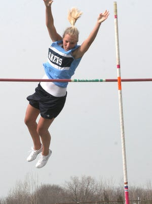 Danbury's Stefini Kosa clears the bar in the pole vault in 2008.