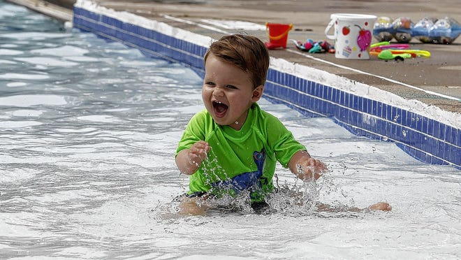 Tripp Paternostro, 1, plays in the water at the Dublin Community Pool South on June 26. It was the first day of the season for the pool which had been closed because of the COVID-19 coronavirus pandemic. The pool is open for three time slots each day -- 10 a.m. to 1 p.m., 2 to 5 p.m. and 6 to 8 p.m. Reservations may be made on the Dublin city website.