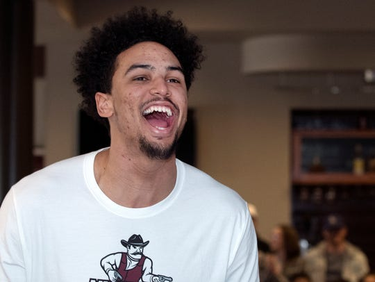 New Mexico State's Eli Chuha reacts to the announcement
