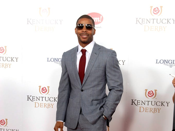 Former UofL football player, Kerry Rhodes poses for a photo on the Derby Red Carpet.  May 03, 2014
