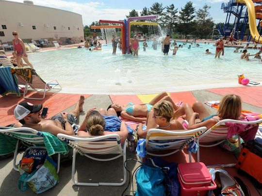 In this Coloradoan file photo, Jason Williams, Kelly Vance, Kelly Matsuda, and Heather Testa enjoy the day at City Park Pool in August 2013.