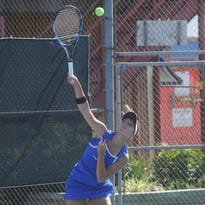 Mountain Home's Cortni Thomas serves during a match against Harrison earlier this week at Mountain Home Athletic Club.