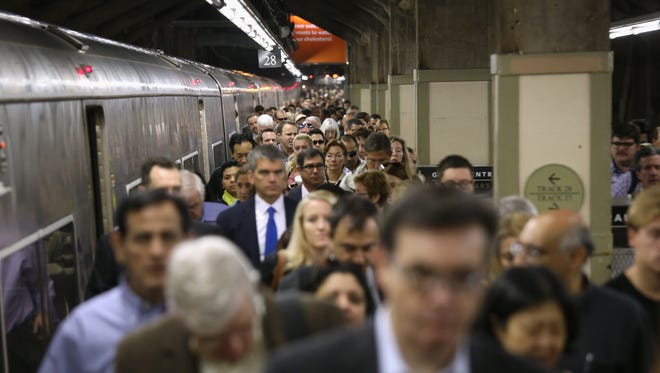 Commuters arrive at Grand Central station on the Harlem Line on Sept. 27, 2013, in New York.