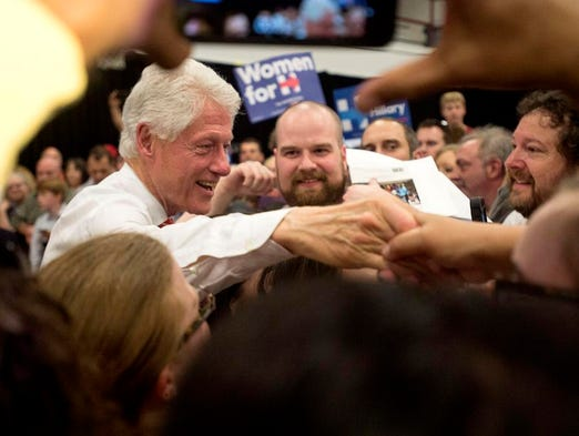 Bill Clinton shakes hands with supporters after his