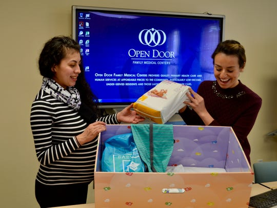 Community Coordinator Alaina Betancourt, right, shows