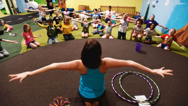 Stefanie Petet of Little You Yoga leads a POP Yoga class at Sci-Port: Louisiana's Science center in Shreveport.