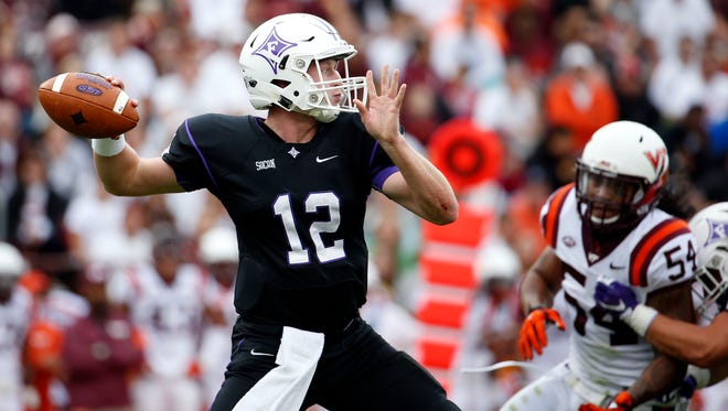 Furman quarterback Reese Hannon, here in last year's loss at Virginia Tech, is a four-time captain for the Paladins. But he may or may not start tonight at Spartan Stadium. Junior P.J. Blazejowski, who took over for the injured Hannon late last season, is the other option.