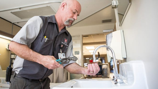 Stanley Adams, a plumber with IU Health Ball Memorial Hospital, helps flush the taps of every faucet in the hospital with chlorinated water. The hospital is taking precautions ahead of test results to kill bacteria that could be linked to a patient with Legionnaires' disease.