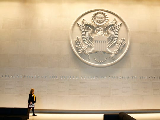 In this Wednesday, Dec. 13, 2017 file photo, a general view of the main lobby entrance with a large Department of State embossed seal, along with all the names of the ambassadors to the Court of St James's at the new United States embassy building during a press preview near the River Thames in London.