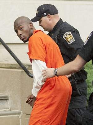 Jamel Booker is led into Tompkins County Court in June 2013 prior to being sentenced to 25 years in state prison in connection with the shooting of Ithaca Police Officer Anthony Augustine.