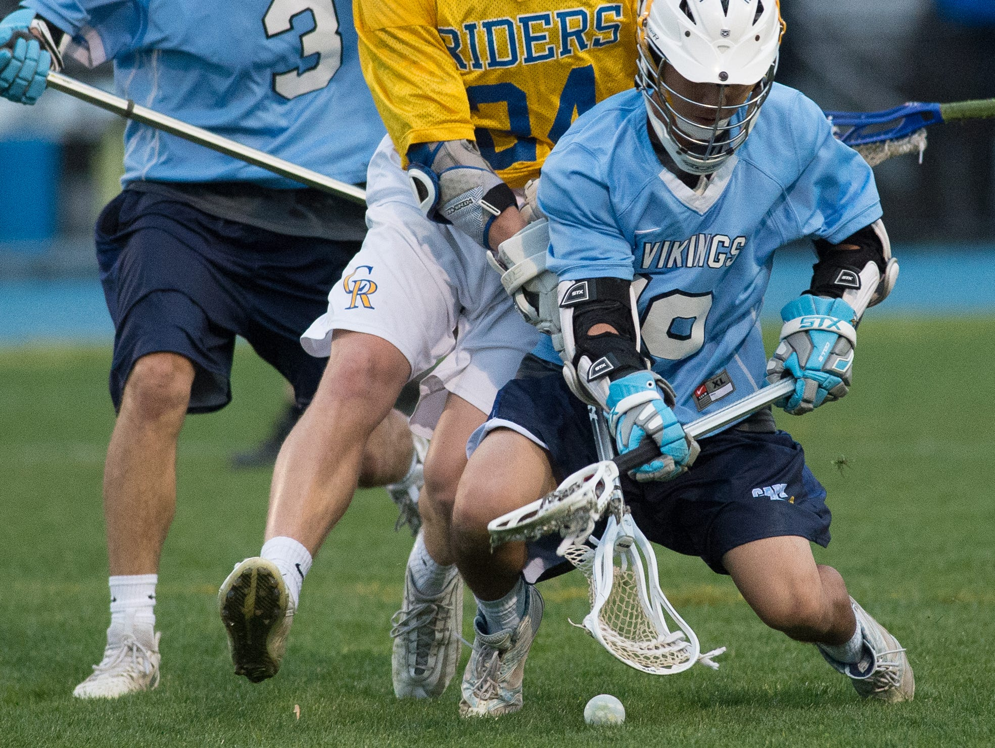 Cape Henlopen's Joey Kung (19), front and Caesar Rodney's Jack Bobel (24) battle for a loose ball in the second quarter of play.