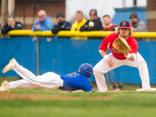 James M Bennett first baseman Cade Hurley (11) watches in a throw during a pick-off attempt aginast Stephen Decatur at Stephen Decatur High in Berlin on Thursday, March 31.