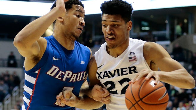 Xavier Musketeers forward Kaiser Gates (22) drives to the hoop in the first half.