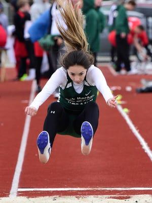 Oak Harbor's Cora Domanowski won the long jump Tuesday at Port Clinton.