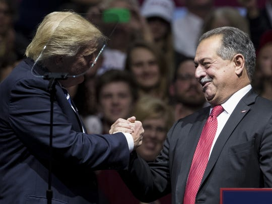 Then-President-elect Donald Trump introduces Andrew N. Liveris, chief executive officer of Dow Chemical at the DeltaPlex Arena, Dec. 9, 2016 in Grand Rapids.