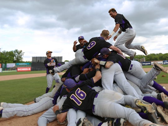 The Cal Lutheran baseball team forms a large dogpile at the mound after winning the Division III College World Series.