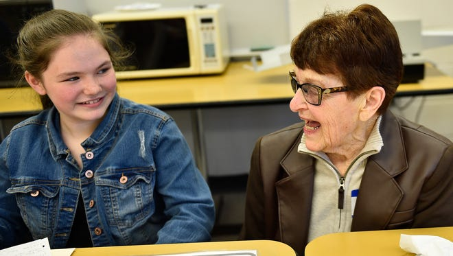 Jeanne Monn, right, answers questions posed by student Samantha Martin. Chambersburg Area Middle School South students met with senior citizens during the Share Your Wisdom event at the school on Friday, May 12, 2017. Senior citizens met with small groups of students who interviewed them. The sessions are a part of the English Language curriculum.