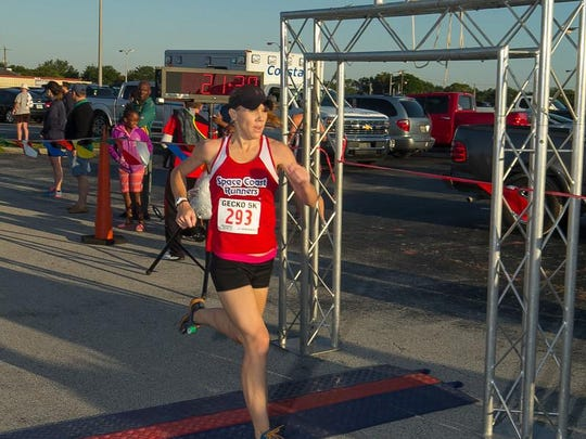 Kristen Klein is seen finishing the Run for the Gecko 5K in May wearing her Space Coast Runners singlet. Klein is co-captain of the 2016-17 Space Coast Runners racing team.