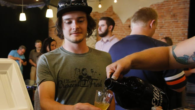 Thomas Hodges of Lansing samples a microbrew from Ellison Brewery & Spirits of Lansing Tuesday evening, May 24, 2016, at the Local Brewer Showcase News & Brews at the Old Town Marquee in Lansing.