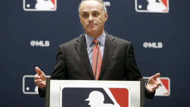 FILE - In this Nov. 21, 2019, file photo, baseball commissioner Rob Manfred speaks to the media at the owners meeting in Arlington, Texas.