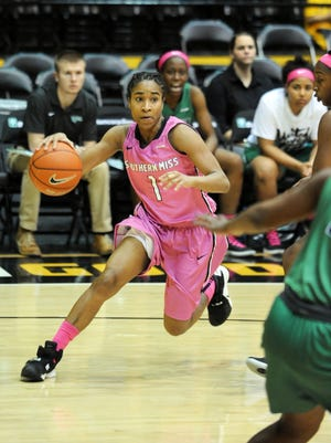 Southern Miss' Tajanay Veiga (1) runs the ball away from the North Texas defense on Thursday in Reed Green Coliseum.