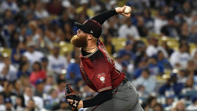 Sep 6, 2017; Los Angeles, CA, USA; Arizona Diamondbacks relief pitcher Archie Bradley (25) pitches against the Los Angeles Dodgers in the eighth inning at Dodger Stadium. Mandatory Credit: Richard Mackson-USA TODAY Sports
