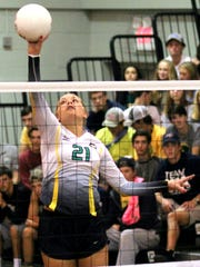 Catholic's Molley Majewski tips the ball over the net during the Crusaders' win over Marianna.