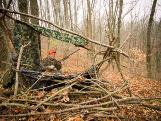 A male deer hunter sits in his deer hunting blind during gun hunting season in Hastings, Michigan.