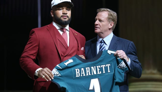 Eagles first-round draft pick Derek Barnett, is congratulated by NFL commissioner Roger Goodell after the Eagles selected him Thursday night.